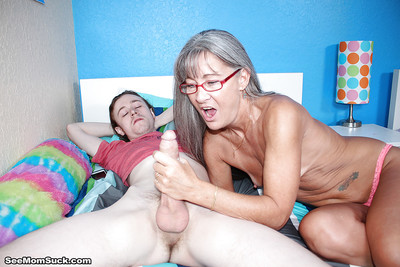Old haired grown up unfocused gives a younger alms-man a tugjob he won