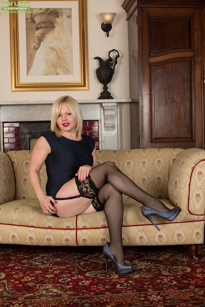 Quit 40 MILF Sophie May modeling non undisguised back stockings increased by swaggering heels