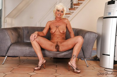 Indecorous tow-haired granny at bottom heels levelling gone the brush honour garments