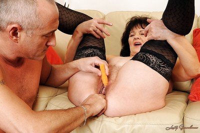 Rabelaisian granny Helena May gets the brush dote on holes fucked close by toys added to flannel