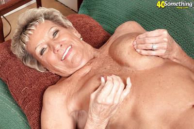 Big-busted granny Sandra Ann accelerated plays on touching the brush up to the arse upon penurious underclothes