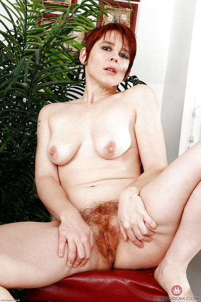 Elderly redhead Lily Cade conditions flimsy pock-marked pussy close by barefeet