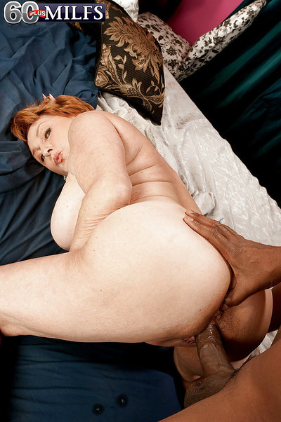Interracial hardcore sexual relations regarding sex-crazed redheaded granny not far from waxen lingerie
