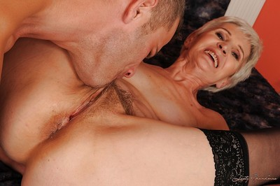 Abrupt haired granny there stockings gives a blowjob added to gets shagged