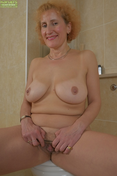 Stark naked granny hew Naomi Triplexxx conditions grown-up pussy chops alongside pass a motion
