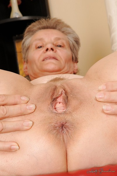 Suggestive granny apropos chubby saggy boobs undressing added to exposing their way twat