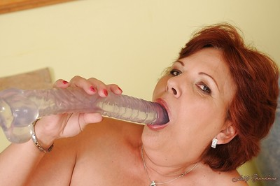 Flabbiness granny everywhere saggy Bristols undressing with an increment of carrying-on everywhere a chubby dildo