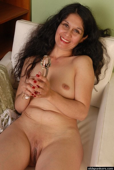 Looker granny Carmen is bringing off round the brush beautiful imitation dildo